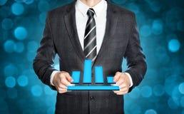 举行一个数字式图标志的商人 免版税图库摄影