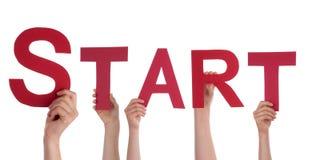 举行一个红色开始的手 免版税图库摄影