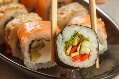 举行与菜和另外s的两双筷子Hosomaki 库存图片