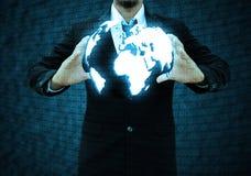 举行世界技术的商人 图库摄影