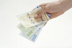 举行丹麦货币的手 库存图片