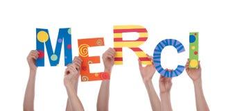 举行五颜六色的Merci的许多手 库存图片