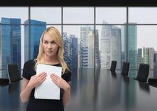 举行企业标志的商人 免版税库存照片