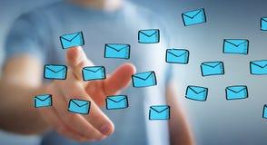 举行和接触浮动电子邮件剪影的商人 库存图片