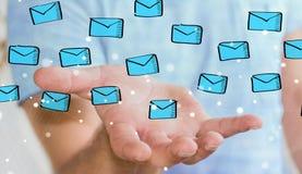 举行和接触浮动电子邮件剪影的商人 免版税库存图片