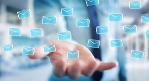 举行和接触浮动电子邮件剪影的商人 库存照片