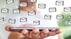 举行在手机的商人电子邮件剪影 免版税图库摄影