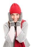 举行她的头佩带的冬天的女孩穿衣 图库摄影