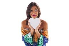 举行心脏形状的妇女 免版税库存图片