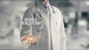 举行手中世界卫生日的医生 免版税库存图片