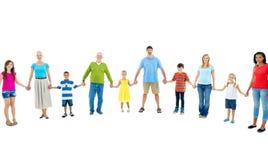 举行手友谊概念的大小组人民 免版税库存照片