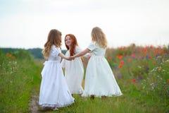 举行手和使用的三个愉快的孩子 库存照片