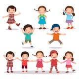举行手和跳跃的愉快的孩子动画片 免版税图库摄影