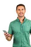 举行智能手机和看的微笑的人照相机 免版税图库摄影