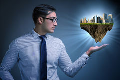 举行未来派城市的计划建筑师 免版税库存图片
