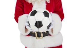 举行橄榄球的圣诞老人的中间部分 免版税库存照片