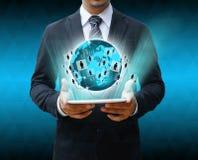 举行片剂世界技术的商人 免版税库存图片