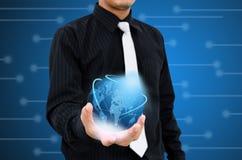 举行现代世界技术通信 免版税库存照片