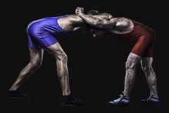举行的两位摔跤手在立场 库存照片