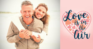 举行的微笑的夫妇的综合图象 免版税库存照片
