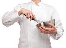 举行碗和扫的烹饪器材 库存图片