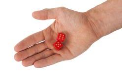 举行红色的手切成小方块 免版税库存图片