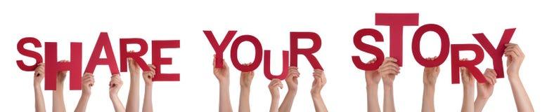 举行红色词的人手分享您的故事 免版税库存照片