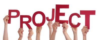 举行红色词项目的许多人手 库存图片