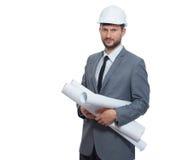 举行许多的确信的建筑师大厦图画计划  免版税库存照片