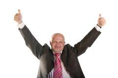 举行赞许的愉快的商人 免版税图库摄影
