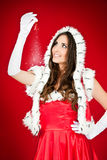 举行魔术圣诞老人妇女xmas的响铃 图库摄影