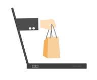举行购物袋概念的电子商务手来 库存图片
