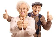 举行他们的赞许的极度高兴的前辈 图库摄影