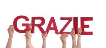 举行Grazie的人们 库存照片