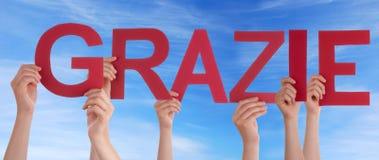 举行Grazie的手 免版税库存图片