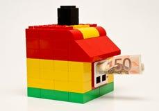 之家和货币 免版税库存照片