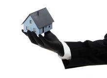 之家由黑色橡胶手套提供 库存照片