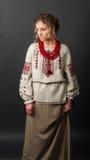 乌克兰刺绣的美丽的严肃的少妇 库存图片