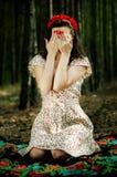 乌克兰女孩在森林里 免版税库存照片