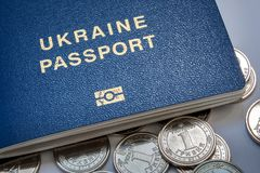 乌克兰护照和新的硬币 库存照片