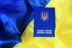 乌克兰的旗子和护照 免版税库存照片