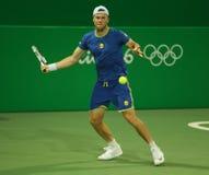 乌克兰的职业网球球员伊利亚・马尔琴科行动的在人` s期间加倍里约2016年奥运会的比赛 免版税图库摄影