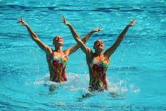 乌克兰的洛丽塔Ananasova和安娜Voloshyna任意竞争在花样游泳二重奏里约的惯例初阶期间2016年 免版税库存图片