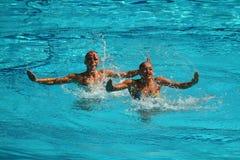 乌克兰的洛丽塔Ananasova和安娜Voloshyna任意竞争在花样游泳二重奏里约的惯例初阶期间2016年 图库摄影