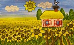 乌克兰语房子的向日葵 库存图片