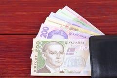 乌克兰金钱在黑钱包里 库存照片