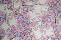 乌克兰货币的钞票在一张白色桌上的是全部 库存图片