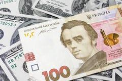乌克兰hryvnia,美元,金钱特写镜头 钞票概念 免版税库存图片