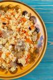 乌兹别克人肉饭、plov、pilaw用肉,红萝卜和巴巴丽 免版税库存照片