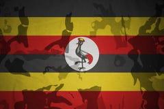 乌干达的旗子卡其色的纹理的 装甲攻击机体关闭概念标志绿色m4a1军用步枪s射击了数据条工作室作战u 免版税库存图片